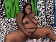 Brown BBW Shows Off Her Body and Bangs